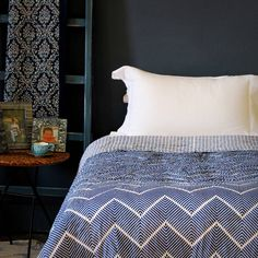 A quilt with a bold geometric design in deep ocean blue on a fresh white background, reversing in block printed bands of blue stripe.Created exclusively for ibbi in the heart of Jaipur by the doyenne of hand block printing, Gitto, these refined and sophisticated quilts are made from 100% cotton mul mul and are hand quilted and hand block printed by master craftsmen using traditional methods and an elegant palette of subdued and strong colours. A bold geometric contemporary design in deep ...