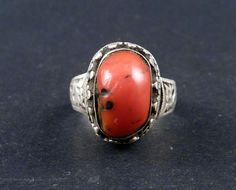 This is an amazing red coral silver tibetan ring with an extraordinary patina, from the Himalayan region. $187 Silver is decorated with filigree and the ring itself has embossed vegetal decoration.  Pearls, turquoise coral and amber are very important for Himalayan adornment culture, as they are believed to have prophylactic properties. Thats why they use them on necklaces, bracelets rings and head adornments.  The size of the ring is 8 american size (17 european size). 1980's