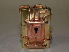 Steampunk locked zippo by TheJeweledTinkerer on Etsy, $120.00