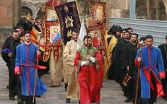 The procession towards the Etchmiadzin Cathedral in Vagharshapat, Armenia for the Christmas Divine Liturgy.