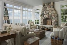 Fieldstone fireplace, painted floors, and those windows...