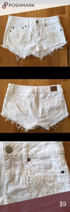 American Eagle White Shorts + Lace Accents Sz 00 American Eagle Outfitters stretch white shorts with lace accents. Size 00. They are in good condition and were kept in a smoke free home. American Eagle Outfitters Shorts