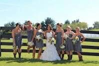Gray bridesmaids dresses with cowboy boots.