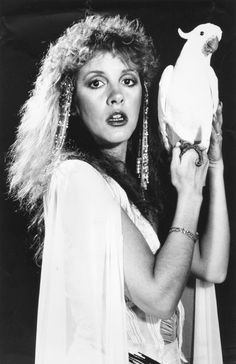 Stevie ~ ☆♥❤♥☆ ~ holding her brother's cockatoo; one of the many photos taken for her debut solo studio 'Bella Donna' album ~ photo by Herbert W. Worthington 111