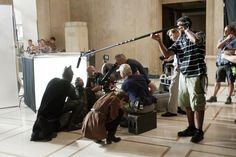"""Behind the scenes photos from """"The Dark Knight Rises"""". Close up on Bale. Cotillard waiting for her moment. Pfister on camera. Nolan watching from above."""