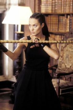 Lara Croft: Tomb Raider: The Cradle of Life (2003).  Stick fighting in the library!