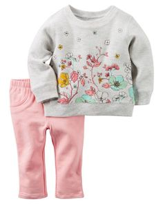 Complete with terry jeggings and a printed terry top, this 2-piece set is on trend!