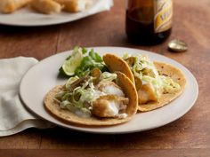 Marcela's Baja-Style Fish Tacos : Beer-battered halibut is fried to a golden crisp, then topped with shredded cabbage and salsa for the ultimate fish taco.