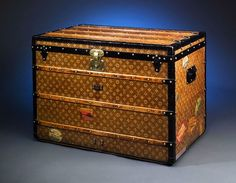 A rare vintage Louis Vuitton steamer trunk from the 1900's, embodying the elegance and sophistication of a bygone era when traveling in style meant taking along every item of clothing you could possibly need.