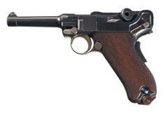 "This is an example of an early DWM Model 1902 American Eagle Luger pistol chambered in the 9mm Parabellum cartridge and fitted with the scarce short ""fat"" (that is, with a wider diameter than later models) barrel configuration. This model was a continuation of the earlier 1902 commercial Lugers intended for the U.S. market, with only 600 to 700 being made in this configuration."