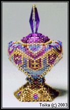 Vessel One at Sova-Enterprises.com A captivating beaded vessel done in 5-sided peyote. You do not need to know this stitch, but knowledge of flat peyote is required. For experienced beaders only! Each step is detailed. Rich text, graphs, and lots of pics along the way! Top comes off to reveal your treasures. Note: This file is over 900kb (at least 6 times larger than most other pattern files). It will take longer to show up in Acrobat Reader. It's worth the wait, please be patient.