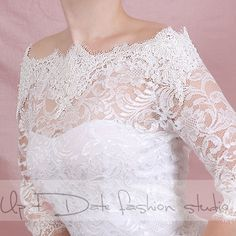 This is a beautiful off-shoulder wedding bolero made of lace with fine French lace trims. The color is available in ivory and white and black. It features pearl embellishment buttons at the back. The lace bolero is made of soft( 2%) stretchy lace and decorated with fine French embroidery lace with delicate beads and sequins at the neckline.The lace bolero has elbow length sleeve, waist length and secured with chic pearl style buttons on the back.  This lace bolero will become gorgeous…