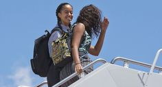 Malia Obama, left, and Sasha Obama board Air Force One as the first family and President Barack Obama head to Roswell, N.M., from Andrews Air Force Base, Md., on Friday, June 17, 2016. The Obama family will then travel to Carlsbad Caverns National Park in New Mexico to celebrate the 100th anniversary of the creation of America's national park system. (AP Photo/Jacquelyn Martin)