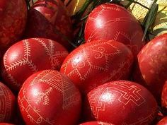 Red Easter eggs done in Serbian Orthodox tradition with warm wax and pen.