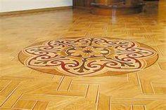 Intasia medallions inlayed into parquet floor!