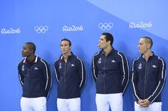 (FromL) France's Mehdy Metella, France's Fabien Gilot, France's Florent Manaudou and France's Jeremy Stravius pose on the podium of the Men's 4x100m Freestyle Relay Final during the swimming event at the Rio 2016 Olympic Games at the Olympic Aquatics Stadium in Rio de Janeiro on August 7, 2016.   / AFP / CHRISTOPHE SIMON