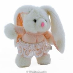 Come dance with me!  I am an 8.5 inch tall girl bunny but stretch my ears and I am 14.5, my head hands feet and feet are plush while my body is a pink fabric. I am wearing a lace tutu. My nose is stitched and my eyes are plastic. My tush tag says I am made in China