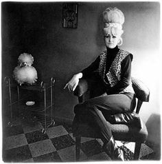 Diane Arbus - Lady Bartender at home with a Poodle