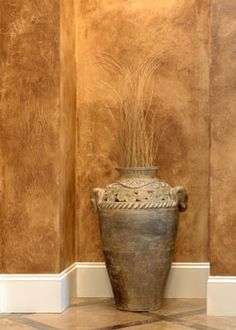 This rustic faux paint technique looks like it could be found in an ancient ruin with warm brown swirls of glaze over glaze