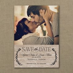 Announce your wedding date with natural elegance! The wood grain background and leaf garlands accent your photo on this petite save the date card. #SaveTheDate
