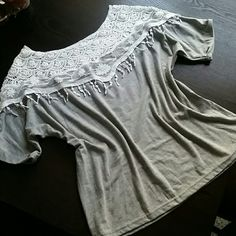 "Gorgeous Lace top- new! Brand new gorgeous gray top with white lace and crochet detail. Unique and on trend. Listed as one size fits all, but I would say it best fits a small or medium. I wear a size 10 and I feel that this is too small for me. Length measures 23"" from shoulder to hem. Tops"