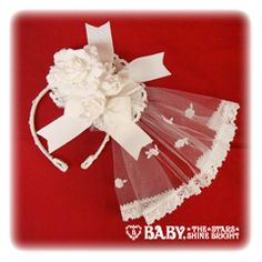 Antoine Bouquet Headbow, $75, Baby The Stars Shine Bright - if I'm ever deranged enough to get married again maybe this will be my veil.
