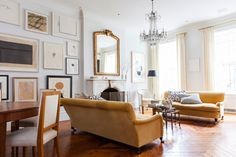 """The living area is set off by a pair of velvet George Smith sofas and a chandelier found at Clignancourt, the famed Paris flea market. Alison skipped a rug in favor of showing off the beautiful wood floors. Perhaps most notable upon entering Alison's home is the pared-down palette. But rather than being overly studied, it's the result of pure instinct. """"I actually love color,"""" she says. """"I have these dreams of red, blue, pink rooms, yet somehow I never go down the color road."""" The one…"""