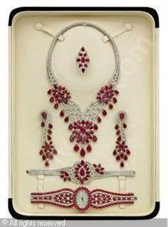 : Set of 6: Ruby and diamond, rubies stated to weigh a total of 203.36 carats, diamonds stated to weigh a total of 62.25 carats,