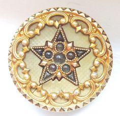 ANTIQUE CELLULOID JEWELED PERFORATE BUTTON STAR w FANCY BRASS BORDER