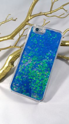 Handmade iPhone cases with dazzling blue glitter and green hearts! Hard clear plastic case with water and blue glitter with green heart shaped confetti inside for a quicksand look. It will easily snap Rose Gold Glitter Wallpaper, Blue Glitter, Water Phone Cases, Iphone 6, Iphone Cases, Phone Gadgets, New Blue, Plastic Case, 6s Plus