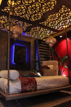 Deep red walls and blue lighting behind the artwork lend a rich quality to this . - Deep red walls and blue lighting behind the artwork lend a rich quality to this relaxing room. Extreme Makeover Home Edition, Meditation Rooms, Relaxation Room, Relaxing Room, Tranquil Bedroom, Zen Meditation, Moroccan Bedroom, Moroccan Interiors, Moroccan Design