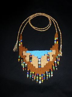 """""""Southwest"""" - 2014 - Adjustable length modeled after """"Turquosie"""", stairstep design, SOLD. Woven by Terri Scache Harris, theravenscache.shutterfly.com Hand woven, handwoven, weaving, weave, needleweaving, pin weaving, woven necklace, fashion necklace, wearable art, fiber art."""
