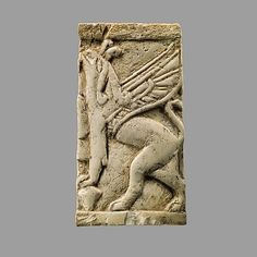 Plaque with griffin, Period: Neo-Assyrian Date: ca. 8th–7th century B.C. Geography: Mesopotamia, Nimrud (ancient Kalhu) Culture: Assyrian