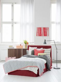 Nothing like the color red to jazz up your bedroom. Bemz bedskirt in Loose Fit Urban style and an Abelvär headboard cover in Rosewood Brera Lino, design by Designers Guild. Bedspread by Bemz in Cloud Brera Fino, design by Designers Guild. Bedspread in Loose Fit Urban in Rosendal Medium Grey. Cushion covers in Stockholm Stripe Sand Beige and Vanilla Yellow Belgian Linen.  www.bemz.com