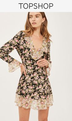 Black tea dress with a floral print and ruffle detail.