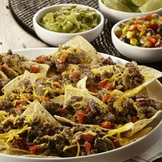 Serve these cheesy ground beef nachos at your next game day party. A perfect easy appetizer that guests will love.