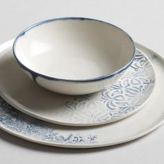 Elegant handmade table settings featuring a mix of hand-pressed Indian woodblock print motifs and painted drip trimmed bowl in indigo. Made in the U.S.A. Sizedi