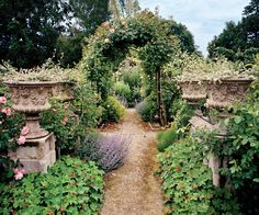 A very British cottage garden look for this trellis entrance....