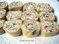 Lynda's Recipe Box: Tortilla Pinwheel Appetizers    This is the one thing I could get my husband to eat last year during the Holidays.  He Loved Them!