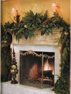 mantle with magnolia leaves, pods and sugar pine cones...luscious