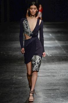 Prabal gurung aw14. Draped, tailored and cutout body con dress with print and plain panelling.