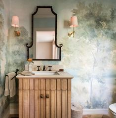 Elegant, whimsical bathroom is covered in hand painted wallpaper lit by Thomas O'Brien Bryant Sconces mounted on either side of a chinoiserie mirror. Hand Painted Wallpaper, Painting Wallpaper, Mural Painting, Wallpaper Murals, Wall Murals, Powder Room Paint, Powder Room Wallpaper, Powder Rooms, Vanity Room