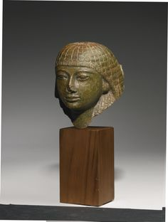 AN EGYPTIAN GREEN PERIDOTITE HEAD OF A MAN, LATE 18TH/ EARLY 19TH DYNASTY, PROBABLY REIGN OF HOREMHAB, 1319-1292 B.C.