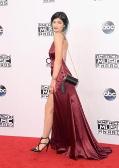 Deep v-neck satin inspired luxury floor length halter bare open back gown worn as seen by Kylie Jenner Details - Polyester - Satin - Imported - Delicate Cold Wash - Fits True To Size Measurements Note