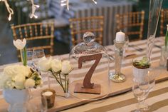 Lasercut wooden table number under glass cloche | SouthBound Bride | http://www.southboundbride.com/fairy-light-fairytale-wedding-at-ashanti-estate-by-tiffany-b-nicole-kyle | Credit: Tiffany B. Photography