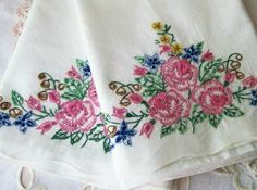 Old linens that were hand embroidered.  I did my share of these.  We then crocheted a lace trim around the edge.
