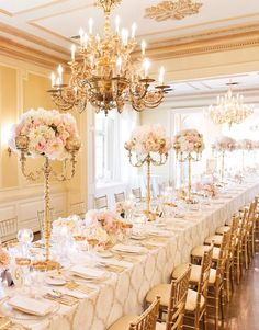 gold candelabra floral arrangements, and short bouquets in between for long tables