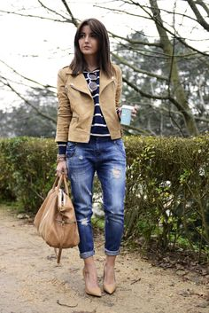 Outfit: beige leather biker jacket, blue striped sweater, distressed jeans, nude heels, beige bag