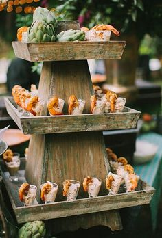 A Cajun-themed menu featuring a tiered stand lined with glasses of seafood salad topped with blackened shrimp.