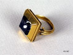 1500-1600s, Germany: Rock crystal in gold bezel with corners raised to form prongs.  Might be an ecclesiastical or episcopal ring.  Rock crystal was considered a precious (low-cost) stone then.